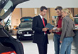 Car Salesman & Customers stock photography