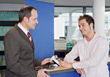 Car Salesman Talking To Customer At Counter stock photography
