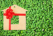Cardboard House With A Red Bow On A Background Of Green Grass stock image