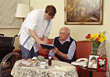 Caretaker Helping Elderly Man stock image