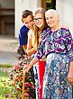Caring Grandchildren Supporting Their Kind Grandmother With Disabilities stock photography
