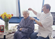 Cartaker Brushing Senior's Hair stock photography