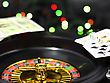 Casino Roulette, Dice And Playing Cards. On Back Background -casino Lights stock photography