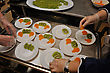 Caterer Prepares Plates Of Dessert With Slices Of Kiwi Fruit And Orange