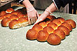 Caterer Separates Freshly Baked Buns For Guests At A Reception stock image