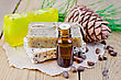 Cedar Oil In A Bottle, Cedar Cone, Three Homemade Soap, Cedar Nuts On The Background Of Wooden Boards stock photo