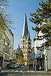 Center Of Bonn, Street And View On Minster, One Of The Oldest Churches In Germany, Emblem Of The City Of Bonn stock photo