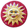 Ceramic Adornment Red Sun Smiles On Red Background stock photo