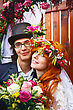 Wreath Cheerful Married Couple, Smiling And Standing In Flower Decorations. Red Hair Bride stock photo