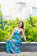 Cheerful Young Lady Wearing Blue Dress Posing Outdoors stock photography