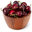 Cherry In Wooden Bowl Isolated On White Background stock photography