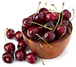 Cherry In Wooden Bowl Isolated On White Background stock image