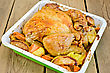 Chicken Baked With Potatoes, Carrots And Apples In A Tray On The Background Of Wooden Boards