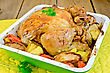 Chicken Baked With Potatoes, Carrots And Apples In A Tray With Parsley, Potholder On The Background Of Wooden Boards stock photo