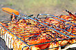 Chicken Tasty Wings Are Fried On Barbecue Grills On A Fire. stock photo