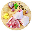 Chicken Thigh Cut Into Round Board With Garlic, Basil, Ginger Isolated On White Background