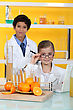 Neutral Children Doing Chemistry Experiments With Orange Juice stock photography