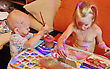 Children Little Girl And Little Boy Draws Paints stock photography