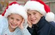 Children with Christmas Hats on stock image