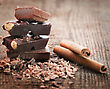 Chocolate Pieces With Cinnamon Stick On Wooden Background stock image