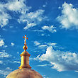 Christian Cross On The Dome Of Church Against Cloudy Sky stock photo