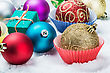 Christmas Balls And Gifts Are Scattered On The Snow stock photo
