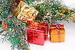 Christmas Boxes And Fir Tree Branches On Gray Background