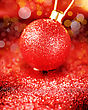 Christmas Bright Decoration In Red Colors. Blurry Image Of Shiny Bauble With Glitters, Sparkles And Bokeh Lights stock image