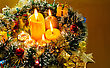 Christmas Carol And Burning Candles Over Golden Background stock photo