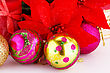 Christmas Colorful Balls With Holly Berry Flowers And Candle Closeup Image