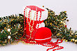 Christmas Decoration With Santa's Red Boot And Green Garland On Gray Background