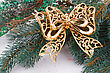 Saturated Christmas Decoration With Yellow Ribbon And Fir-tree Branch stock image