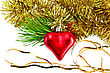 Christmas Decorations In The Form Of A Red Heart On The Branch Of Pine And Gold Tinsel