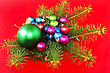 Christmas And New Year Decoration-balls With Fir Branches And Candels On Red Background