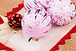 Christmas Pink Balls And Cone On Canvas Background stock image