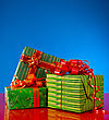 Christmas Presents Against Blue Background stock image
