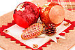 Christmas Red Balls With Cones On Canvas Background stock photo
