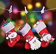Christmas Socks Hanging On A Background Garlands Blinking stock photo