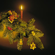 Christmas Tree Branch with Candle stock photo