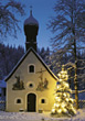 Christmas Tree in front of Chapel stock photography