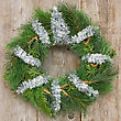 Christmas Wreath Hung On The Wooden Wall stock photo
