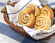 Cinnamon Danish Bun In The Basket On Textile Background