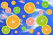 Citrus Fruits Slices, Falling In A Blue Sky stock photography