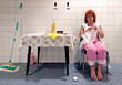 Knitting Cleaning Lady Taking A Break stock photography