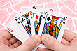 Close-up Human Hands Holding Four Playing Cards stock photography