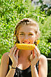 Close-up Outdoor Portrait Of Young Beauty Woman Eating Corn-cob stock photography