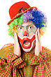 Close-up Portrait Of A Terrified Clown. stock photography