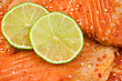 Seafood Close Up Of Salmon With Green Lemon. stock image