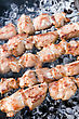 Shashlik Closeup Of Meat Cooking On A Skewer stock photo