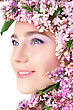 Closeup Portrait Of Beautiful Young Girl's Face Surrounded By Lilac Flowers stock photography